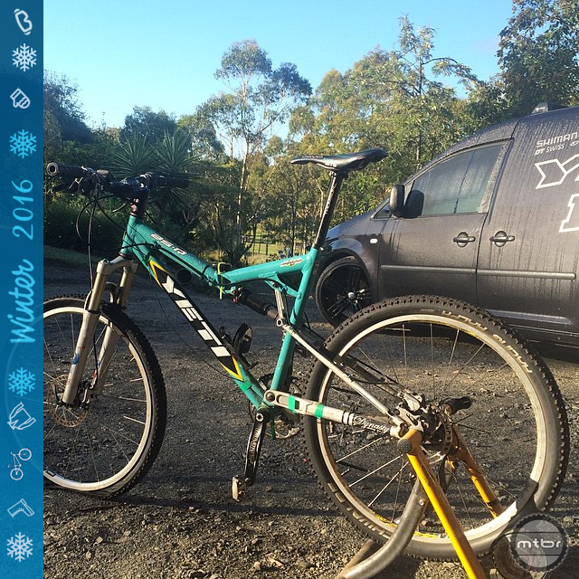 """This is Jared's 2004 Yeti AS-R. While it was never a race bike, he states"""" it has done at least 10x the hours of any other bike over ever had. It became my dedicated trainer bike in 2006 and hasn't moved since. Paint is bolts are fused with rust from a decade of being heavily sweated on. For 10 years this thing has been front and center of my garage. We've been through a lot together!"""""""