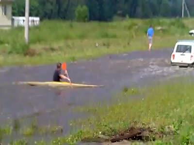 Name:  kayaking_flooded_street.jpg Views: 382 Size:  12.9 KB