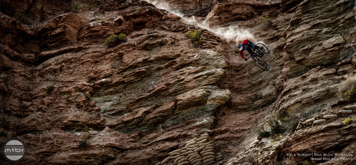 Download this wallpaper of Kyle Strait dropping down a cliff below.
