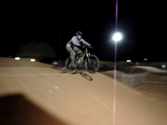 4X racing at Estrella Mtn BMX-last-jump-landing.jpg