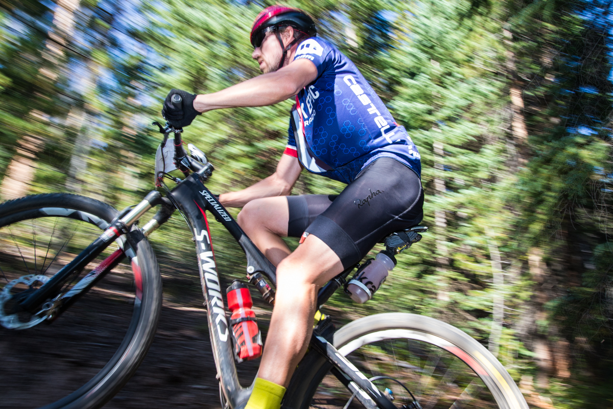 A rider, clad in this year's Breck Epic commerative jersey, climbs one of the steep early trails. While the Colorado Trail portion of Stage-2 is somewhat tame, despite the long slog uphill, there were multiple steep pitches to get to the Colorado Trail. Photo by Liam Doran Photography