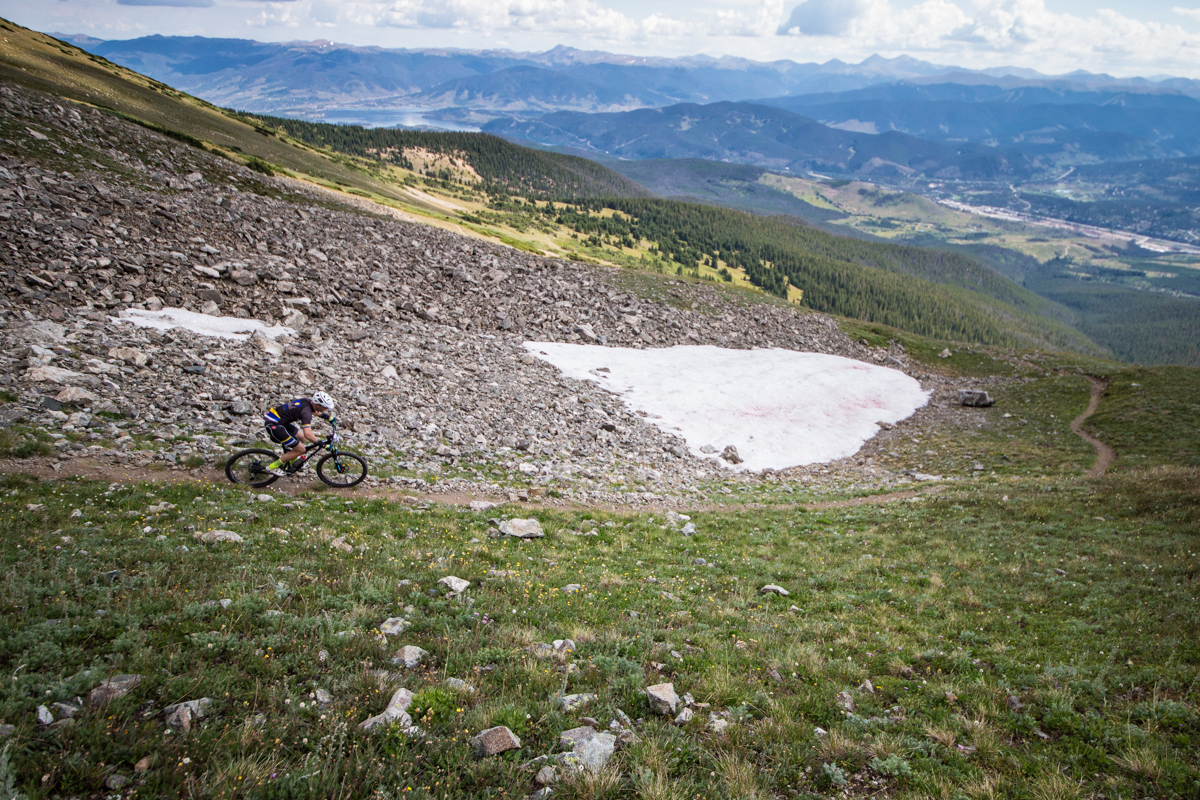 From the summit of Wheeler, riders used to descend straight down to Copper Mountain, but a new course from 2015 takes riders about halfway down the descent, and then back up to the summit of Peak 8 before starting the real descent down toward Frisco and the Peaks Trail. Photo by Liam Doran Photography