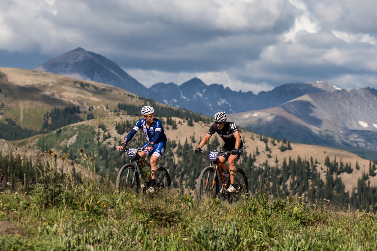 A rider gives one final look back at the expansive landscapes and views that were plentiful throughout the entire week of racing. Photo by Liam Doran Photography