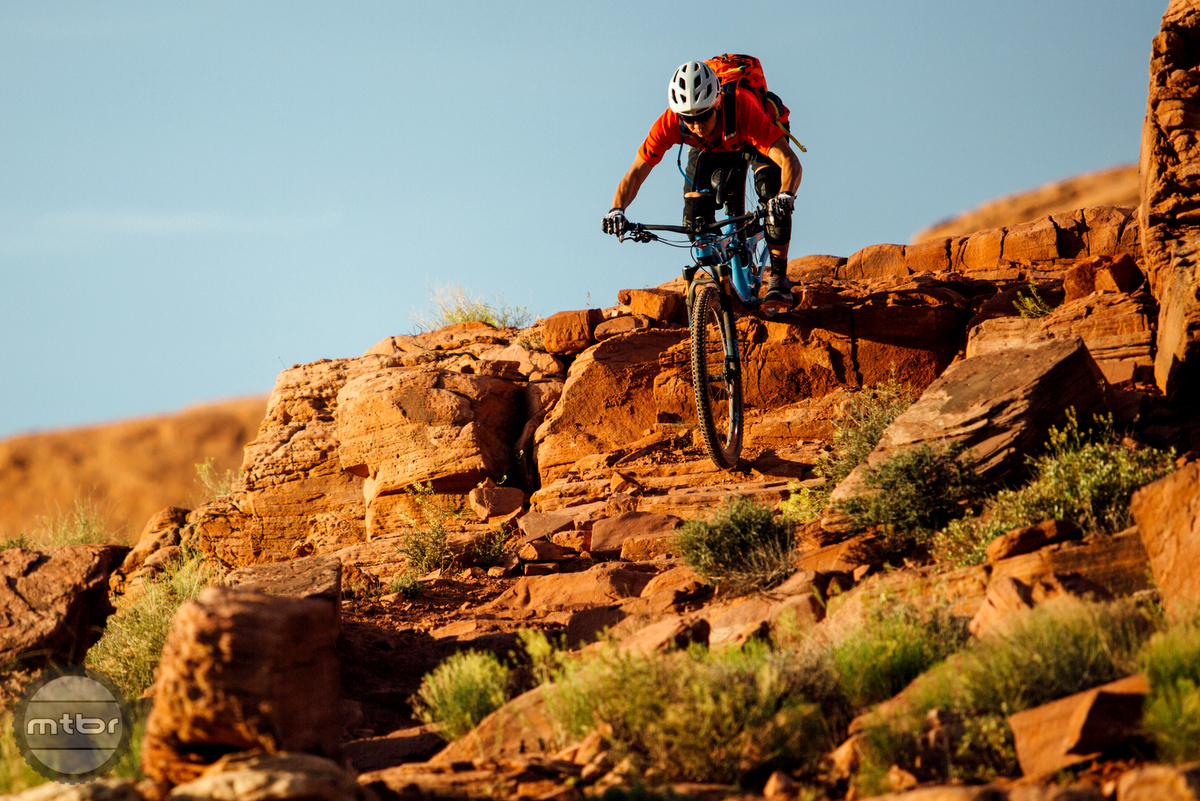 Doing a big drop roller in Moab, the Skyline keeps it low and doesn't shift up the shoulders to upset the critical balance point. Photo by Lear Miller