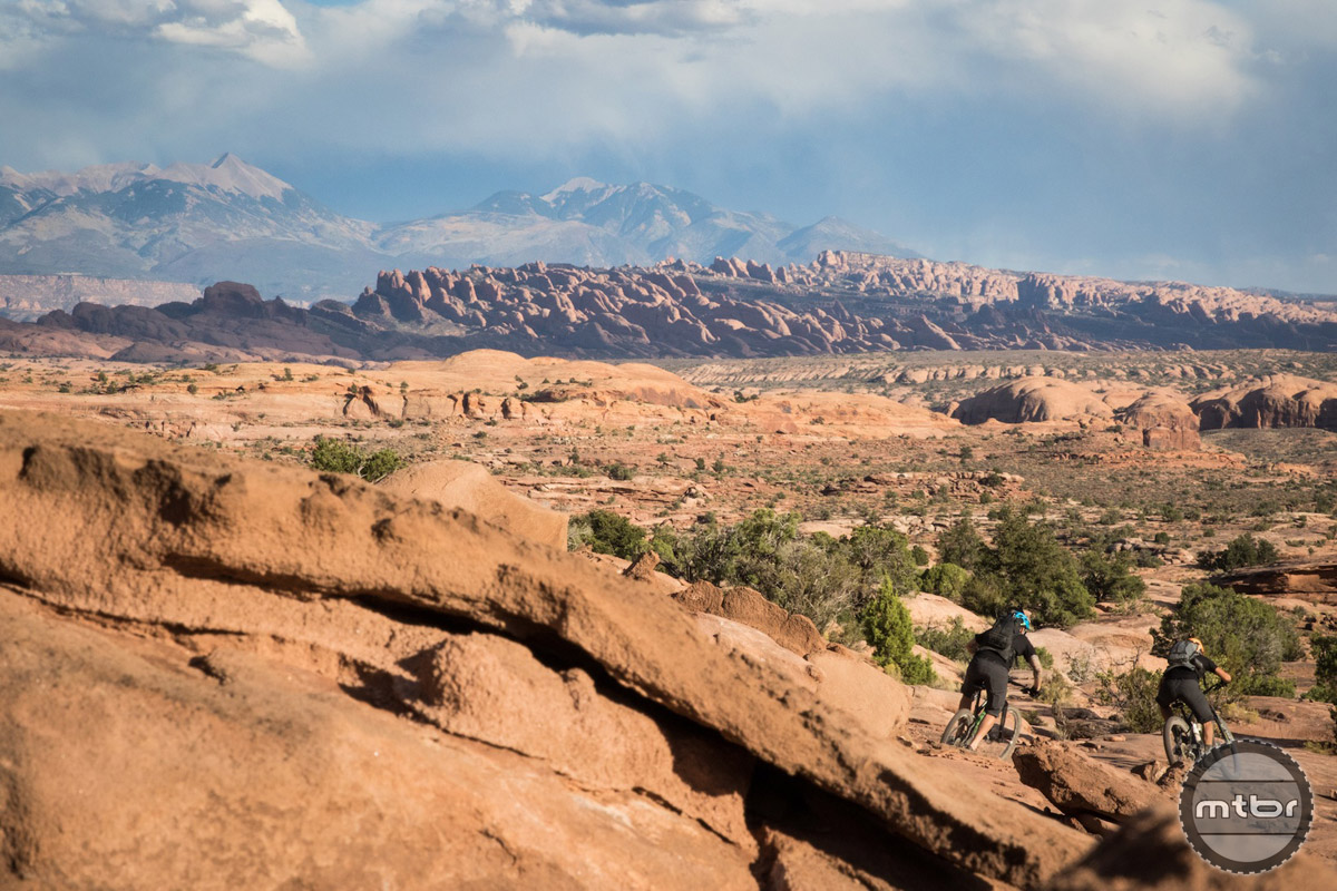 Riders descend Bull Run, part of the Magnificent 7 trail network outside Moab, UT. Photo by James Adamson – dropmedia.tv