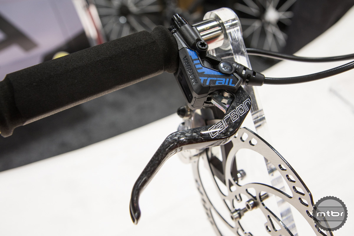 With less weight at the back and modified trail performance, this brake has been optimized for trail use. Weighing in at 332 grams the MT Trail Carbon is 15% lighter than the MT7 and just a shade heavier than the MT8, but still provides superb performance. Features include Carbotecture SL brake lever housing, carbon handlebar clamp, ergonomic shaping, 2-finger brake lever, and carbolay forged 4-piston brake caliper with banjo magnetiXchange brake pistons for easy brake pad replacement. Designed and engineered in Germany. $599