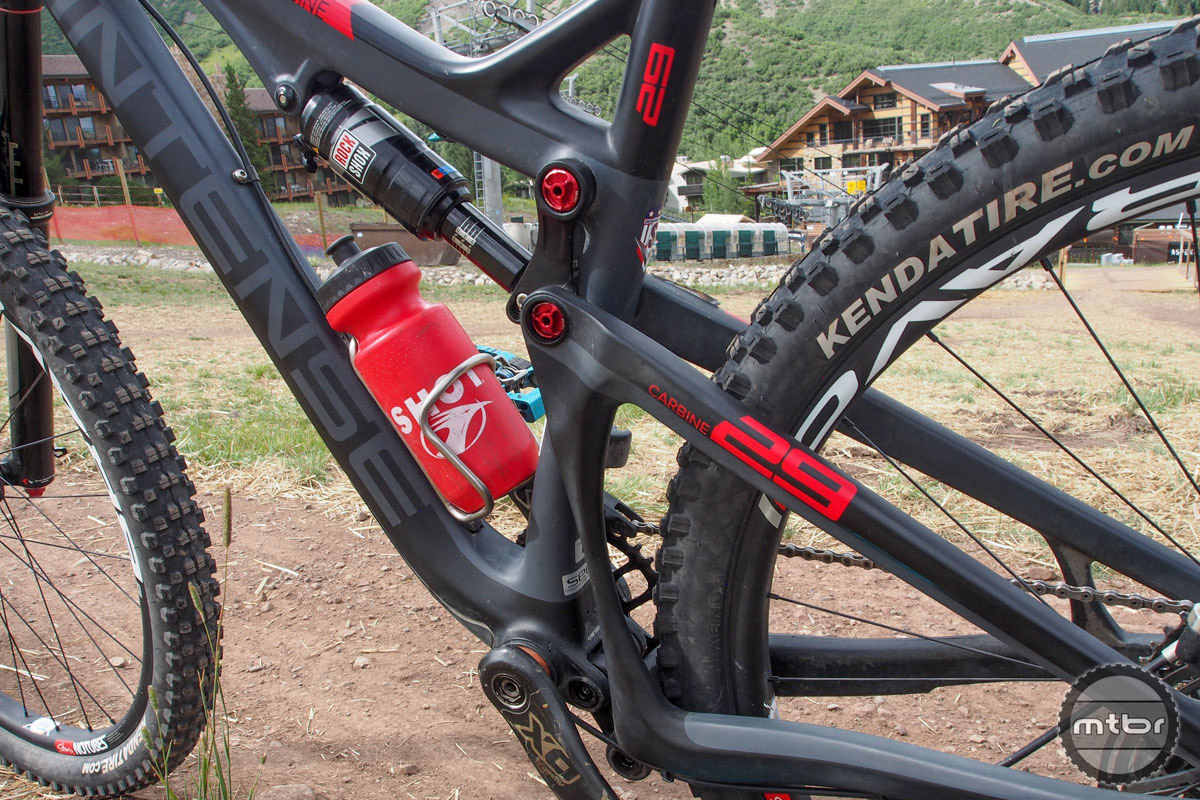 Rear travel can be adjusted by changing where the rear shock is mounted on the upper link. This doesn't affect the bike's geometry. Of course Broderick rarely (if ever) reduces suspension when racing on the EWS circuit.