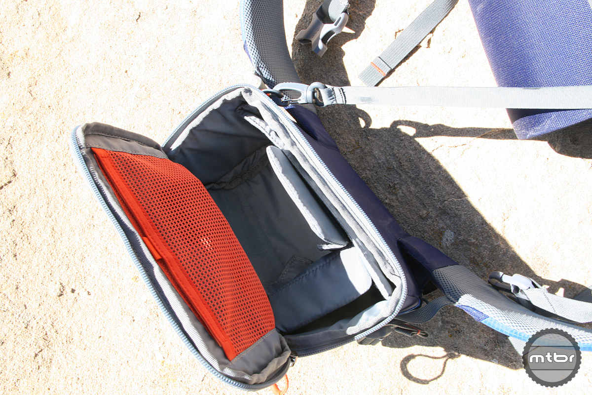 Belt pack interior with dividers removed and camera leash.