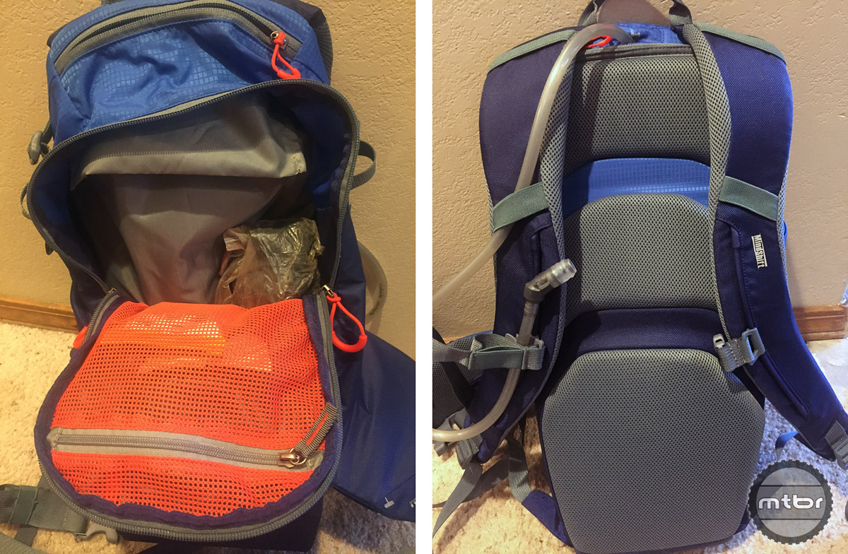 Inside of back pack is a mesh pocket, small pocket on top, zipper pulls on all zippers, and compression strap on the top left side of pack.