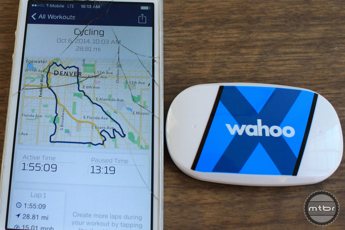 Sans strap, the TICKR X's is about the size of a credit card. The author's well-worn iPhone shows some post-ride results on the Wahoo Fitness App. The device is compatible with Strava and more than 50 other fitness apps.