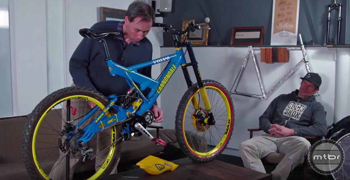 Master bicycle restorer Tasshi Dennis explains the bike's transmission box.