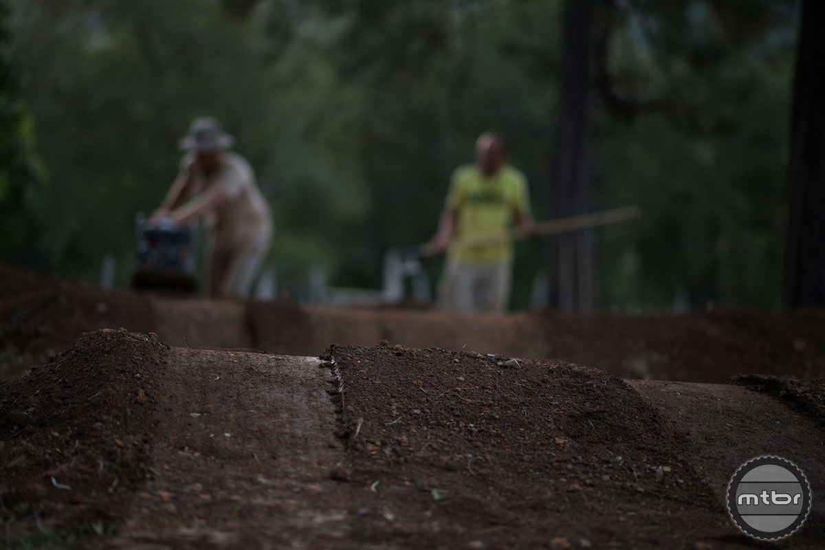 With the help of locals and a two and a half tonne mini digger, it is possible to build a pump track in 5 days. Photo courtesy of Commencal