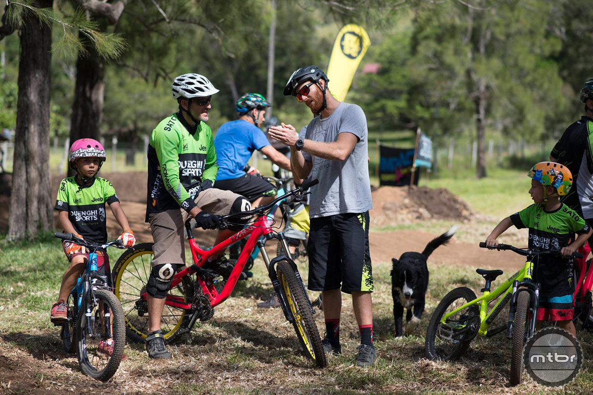 Mentoring local kids and  supervising the locals during their Enduro training in NC. Photo courtesy of Commencal