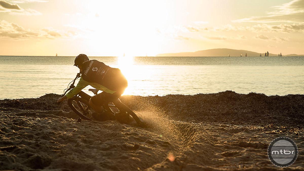 Riding flowy singletrack down to the beach. Photo by Jochen Haar