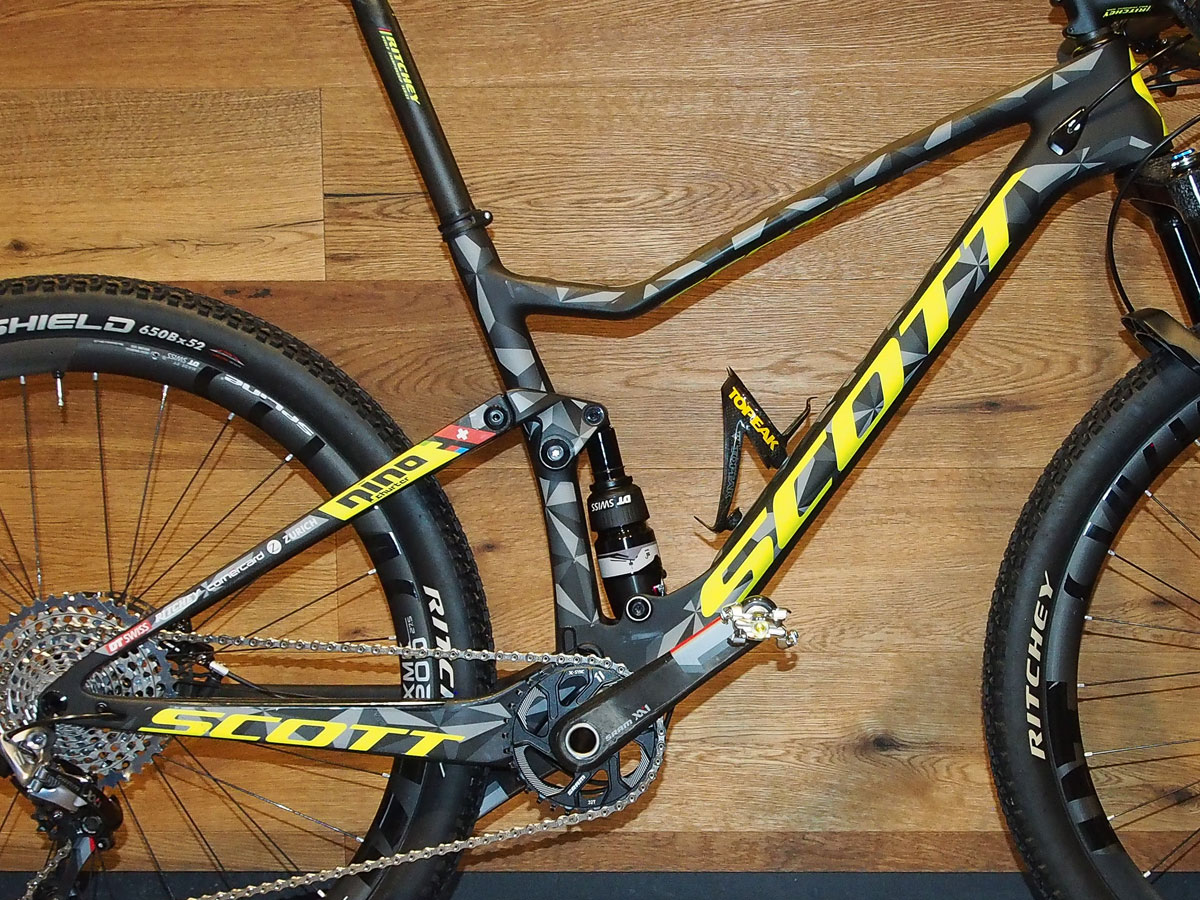 "As you can see from this photo and the one below of Schurter's ""old"" full suspension racer, the primary differences are the linkage and shock mounting. Instead of the slender swing link, the ""spy shot"" bike utilizes a rocker mounted on the seat tube."