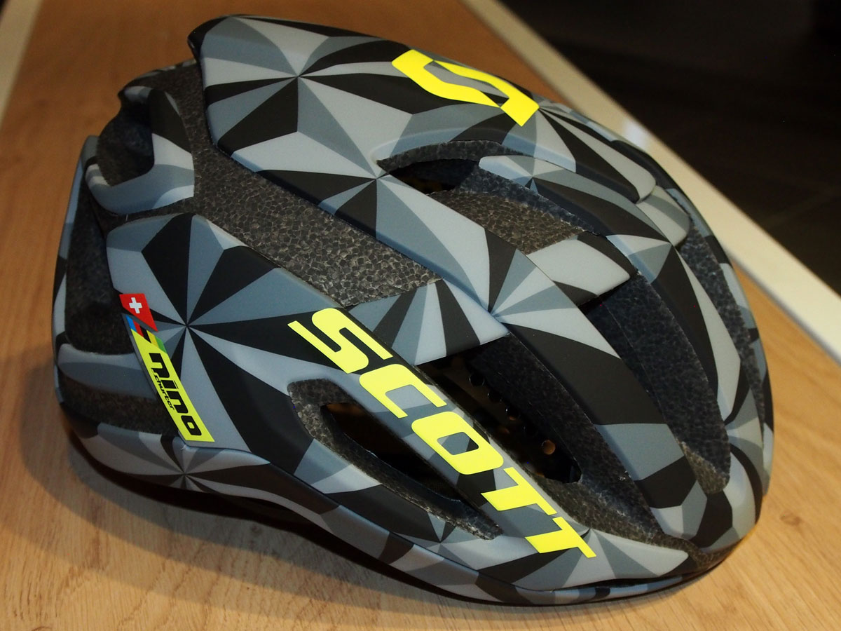 "Also on display in Scott's ""spy shot"" showroom is this helmet. It looks more road than MTB, but it has Schurter's name on it, so perhaps they're targeting the XC racer crowd as well."