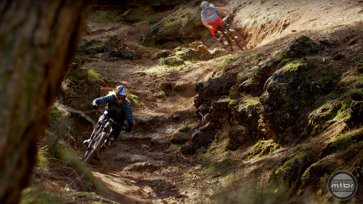 Rachel Atherton and Casey Brown take aggressive lines at full tilt.
