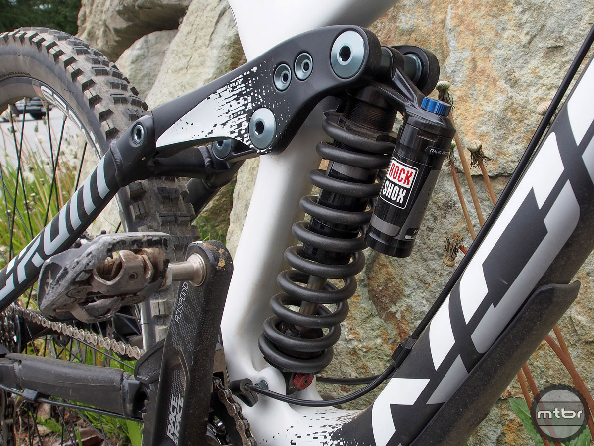 Rear shock is the Rockshox Kage RC coil spring. The downtube (it's carbon remember) is well armored in case of rock strike or worse.