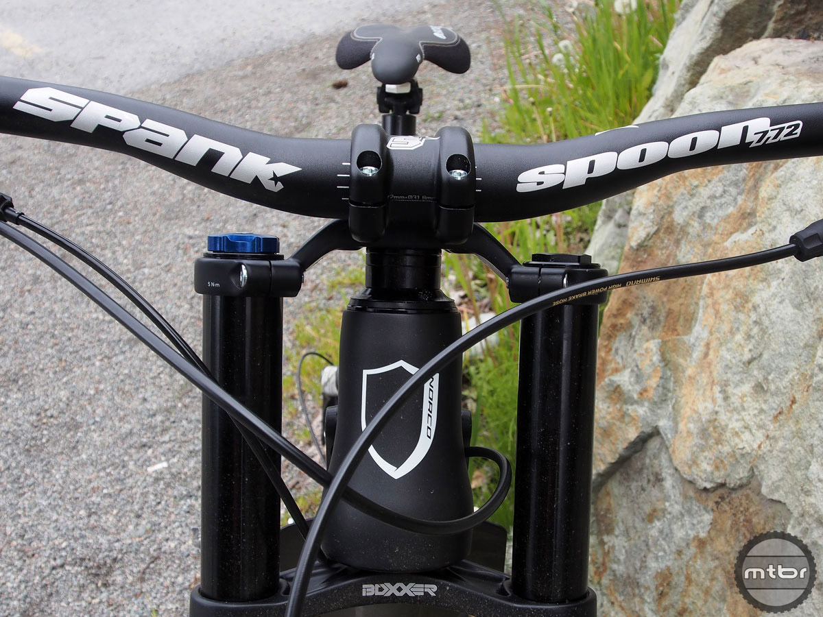 Bars by Spank, suspension by Rockshox, and one burly headtube by Norco.