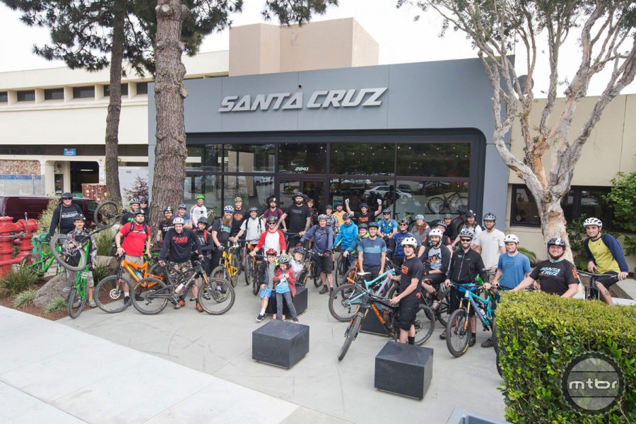 A group ride gathers at the headquarters.