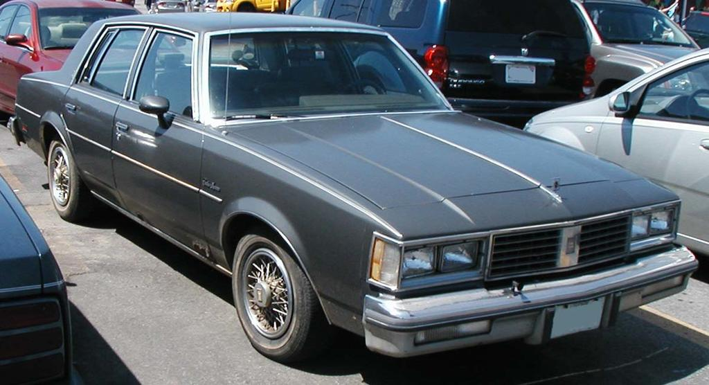 Should Rich sink money into his car or bicycles?-oldsmobile-cutlass-supreme.jpg