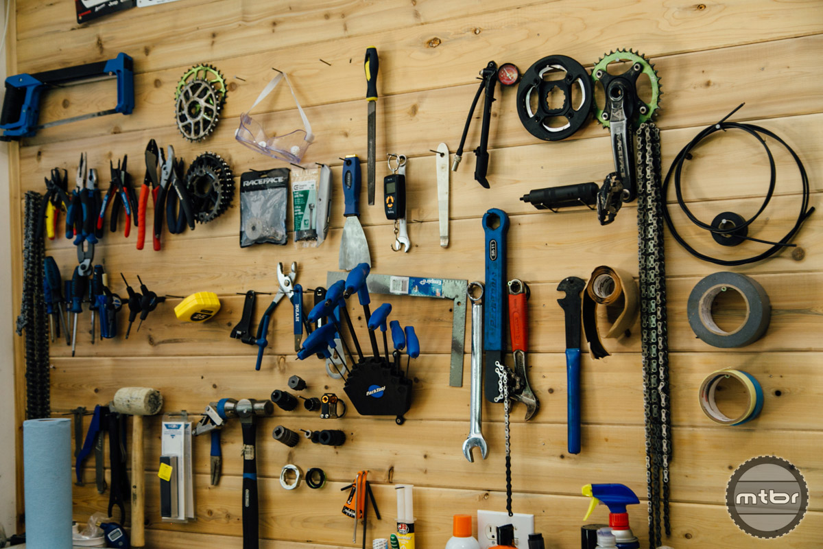 In addition to tools, the workspace is brimming with drivetrain components.