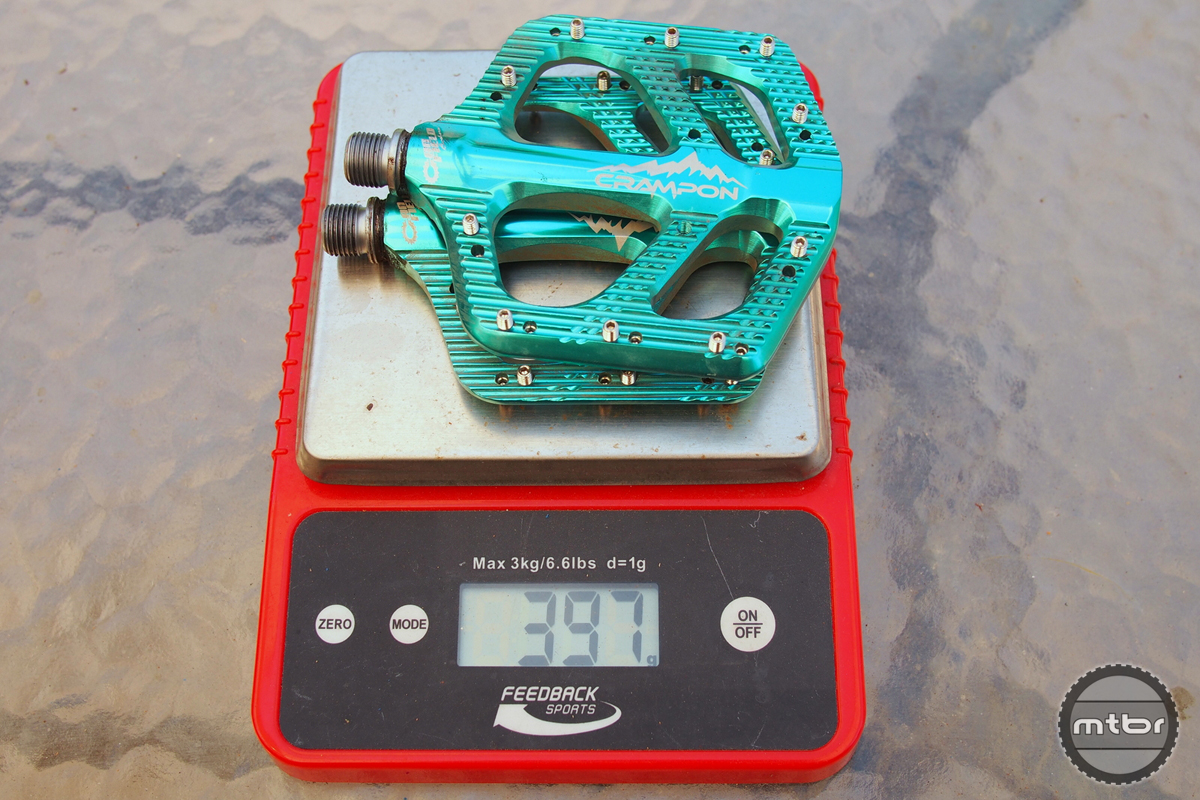 Weight is 397 grams for these thin, wide pedals.