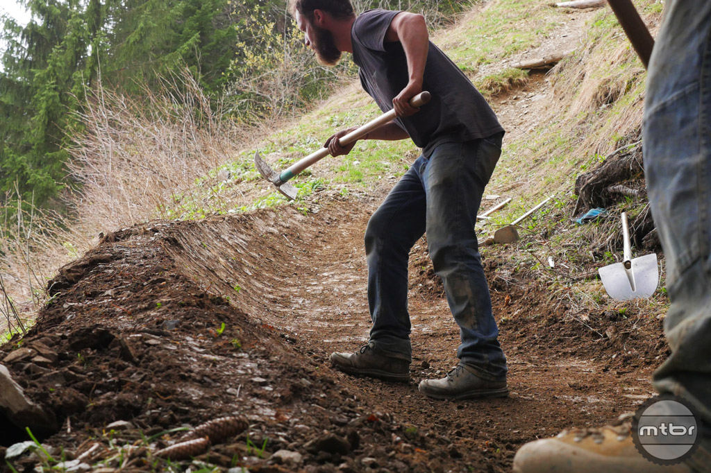 Shaping a berm during recent upgrades for the 2016 season at Champéry Bike Park.