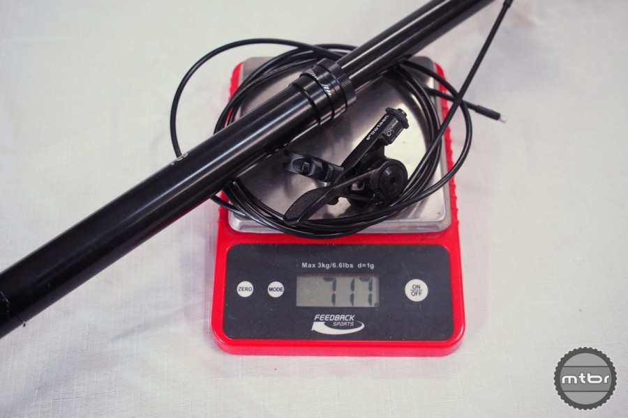 Complete weight with uncut cable is 717 grams.