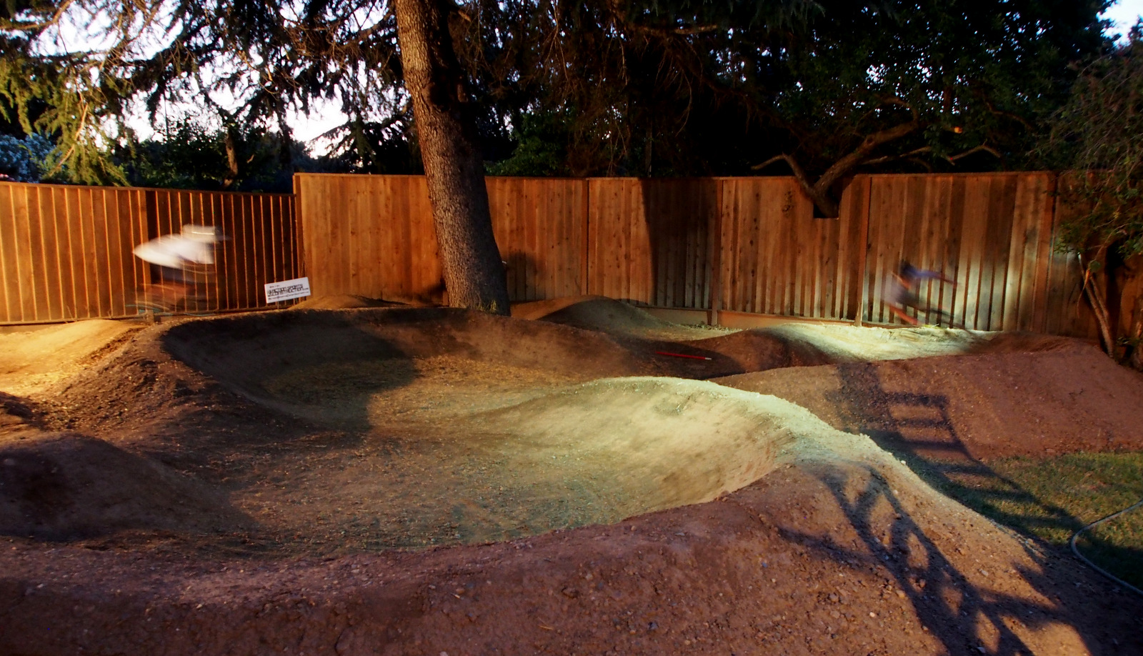 Backyard pump track at night