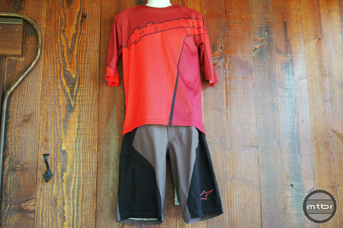Lightweight black/brown shorts with a red top is a good combo.