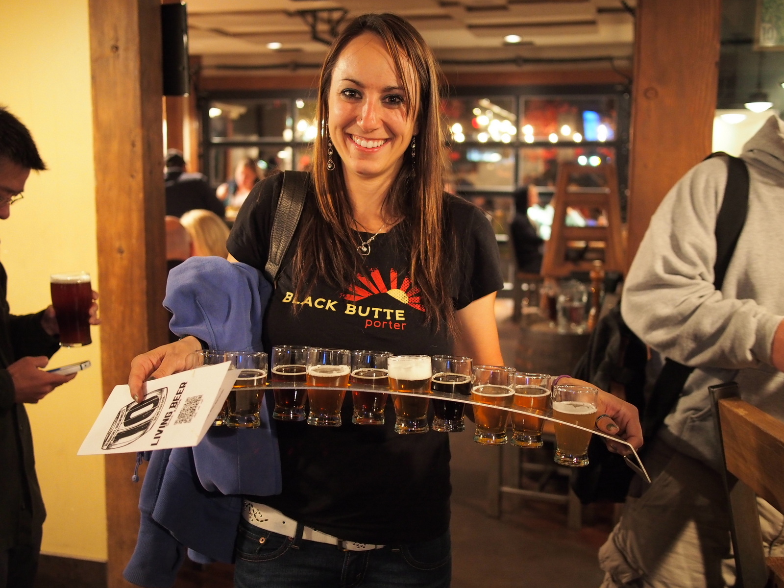 Sonya Looney with the Ten Barrel Brewing beer sampler