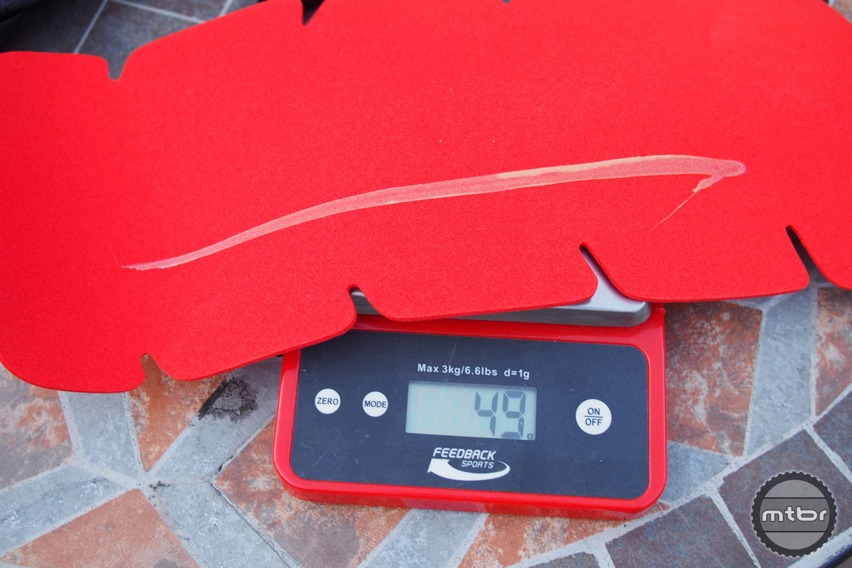 Weight of each back protection pad is just under 50 grams.
