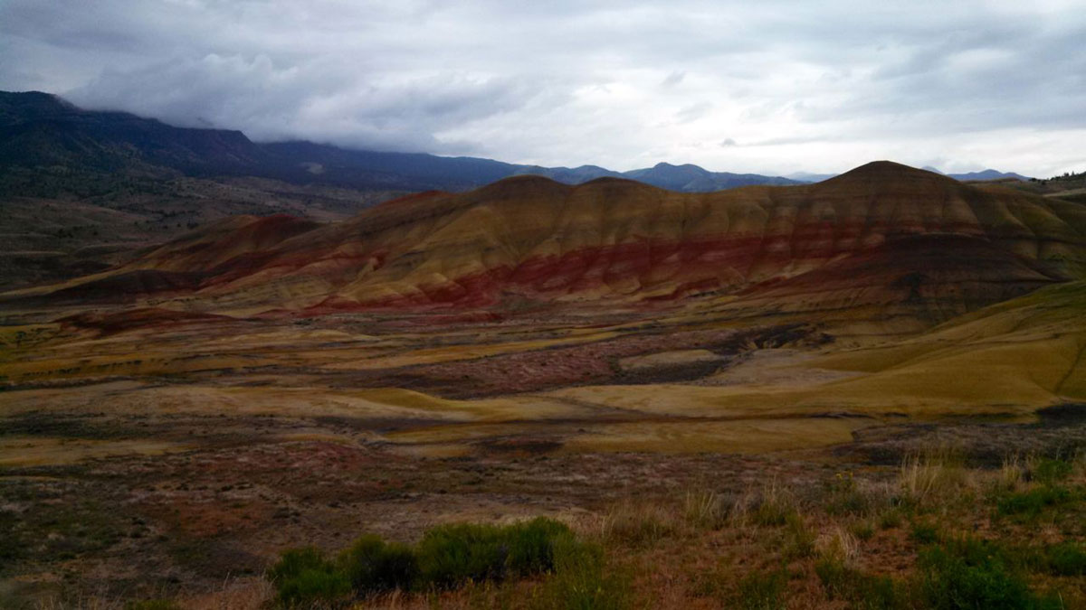 An optional dirt road route passes the Painted Hills, part of the John Day Fossil Beds National Monument.