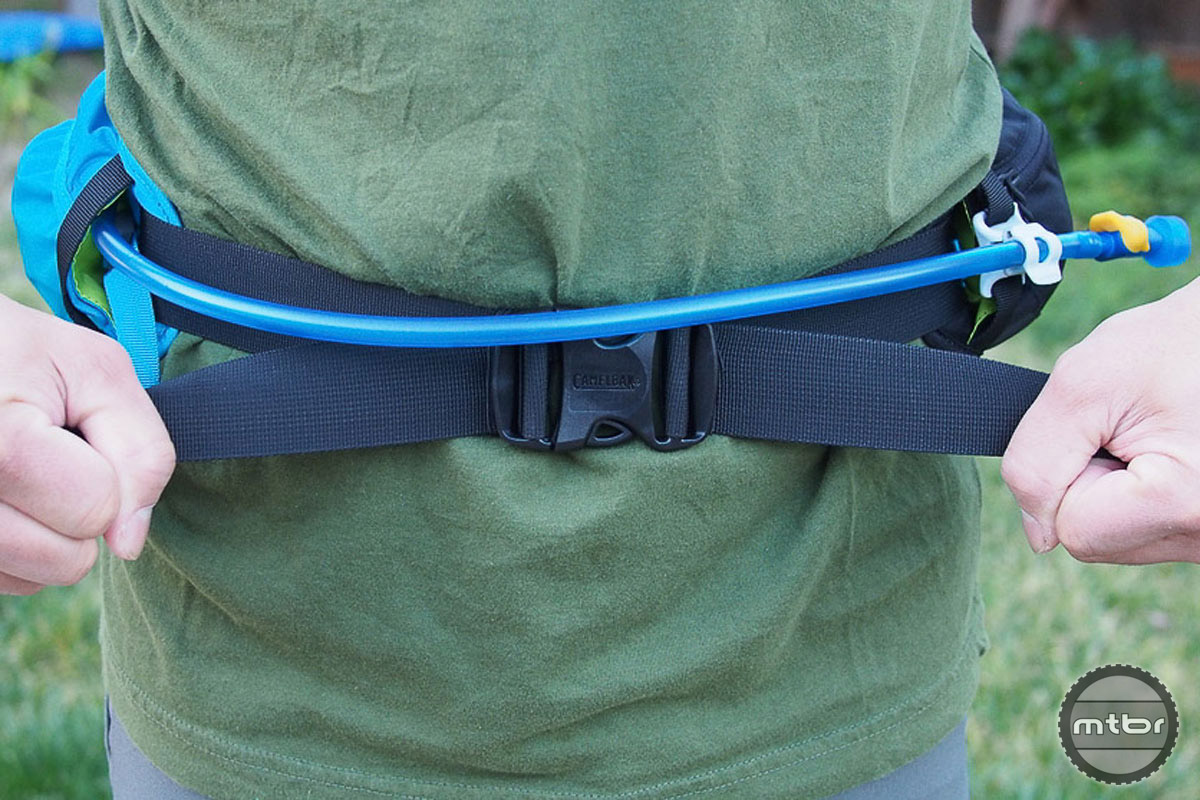 The waist belt cinches down easy and stays in place. The hydration hose attaches to a magnetic tube trap.