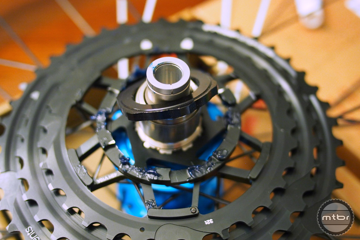 The lock ring holds the big three cogs in place.