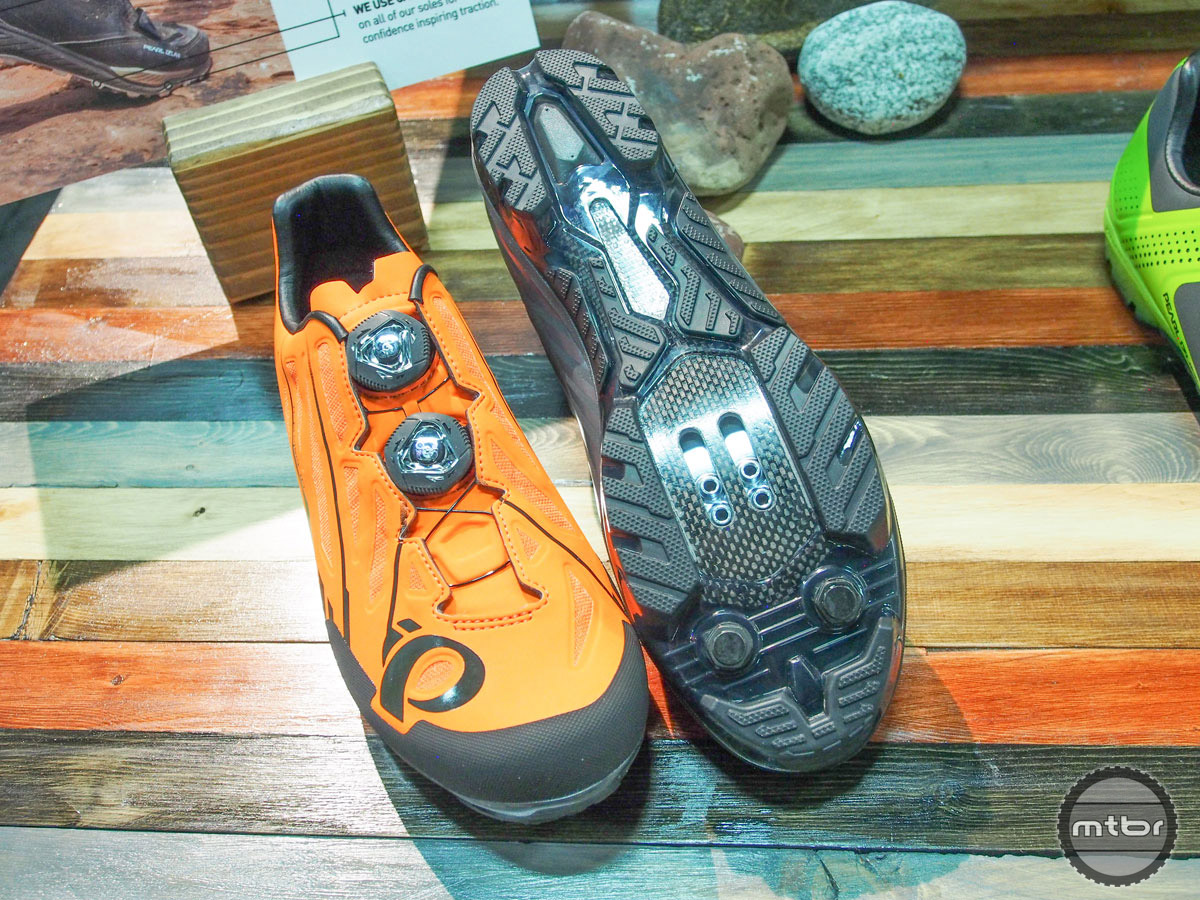 The outsole is compromised of hollow TPU lugs with rubber tips co-molded on for improved traction.
