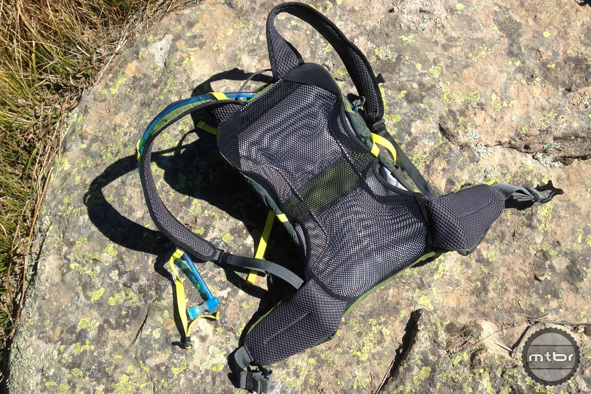 The highly breathable back panel utilizes a layer of mesh tensioned around a wire frame to prevent the pack from compressing against your back.