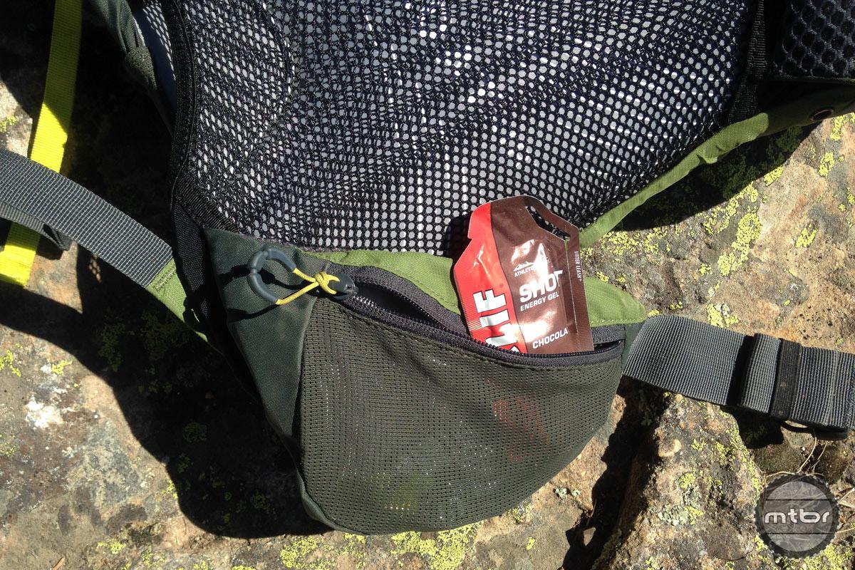 A pair of zippered mesh waist belt pockets allow quick access to snacks.