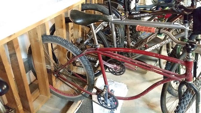 Lining bikes up in garage-rack.jpg