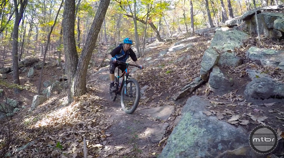 "Compressing at the bottom of one of the downhills preparing for an 18"" step up."