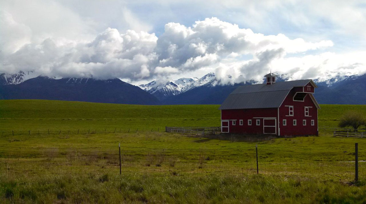 Red barns such as this are a common sight along the bucolic farmland at the foot of the Wallowas.