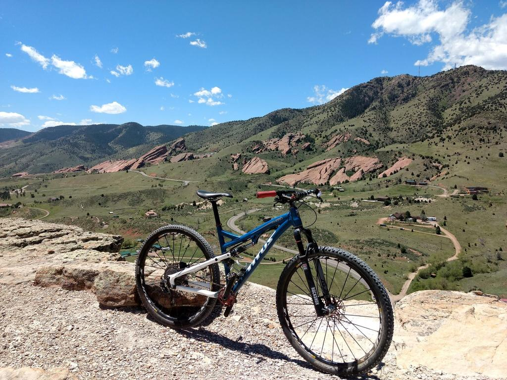 One picture, one line.  No whining. Something about YOUR last ride. [o]-redrocksfromdakotaridge.jpg