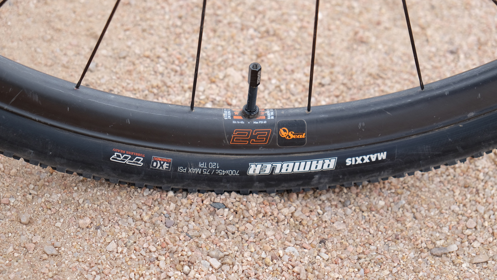 Rusch rolls on ENVE G23 carbon rims with Maxxis 700x40 tires. Orange Seal keeps punctures at bay.