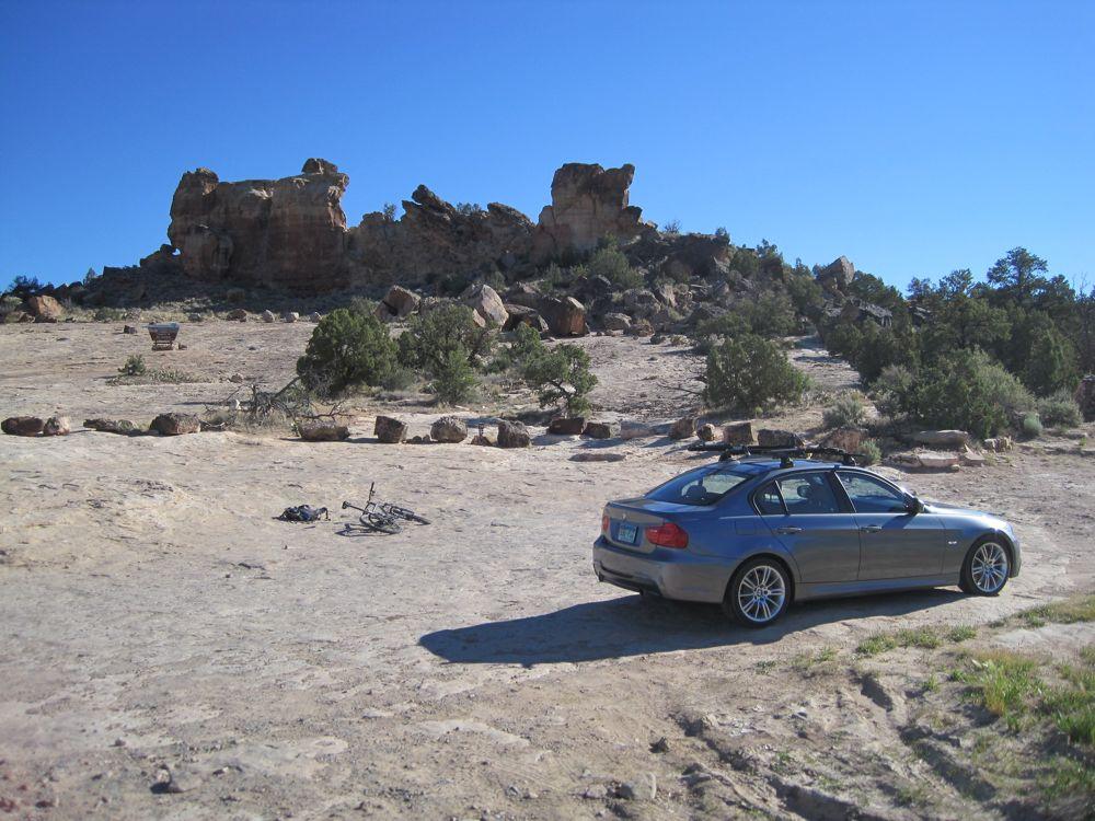 Car and Biker on the Road-sand-canyon-trailhead.jpg