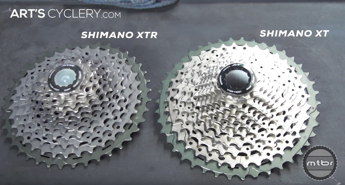 Go with an XT cassette over an XTR cassette. It shifts almost identically to an XTR cassette, but will last longer because it is made of steel rather than titanium.
