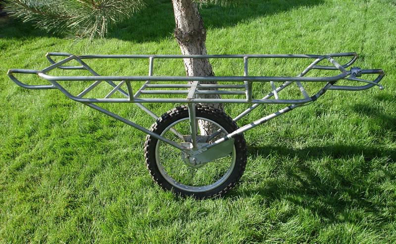 Hauling one big rock-single-wheel-elk-deer-cart-l.jpg