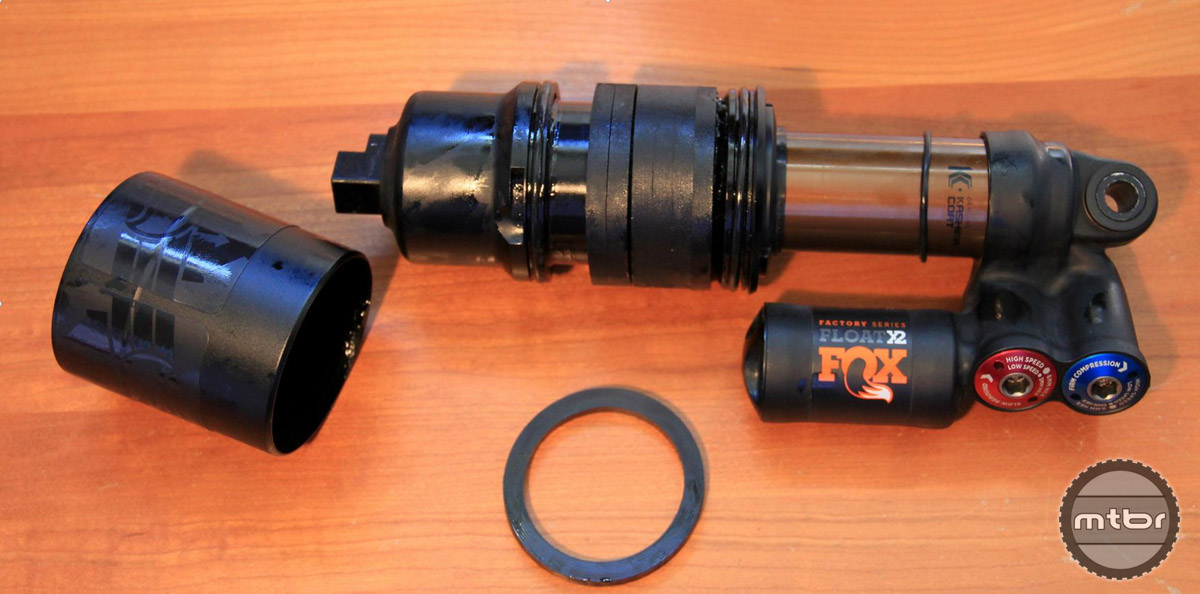 FOX Float X2 disassembled for air can volume modifications.