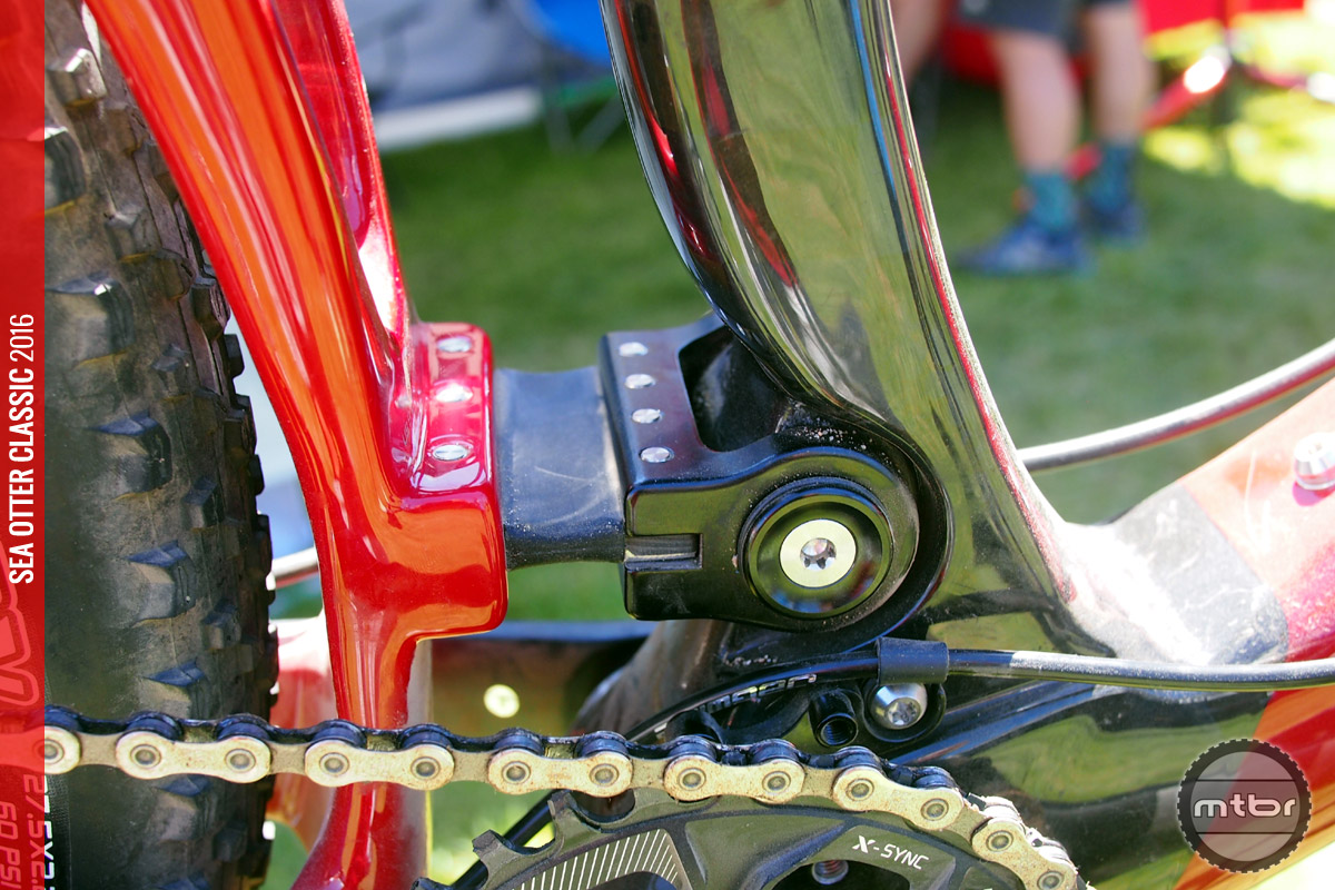 The Living Link carbon leaf spring replaces the lower linkage of a four bar design.