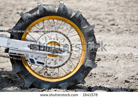 Name:  stock-photo-tire-on-motorcycle-paddle-tire-used-on-dirtbike-for-hillclimb-1641578.jpg